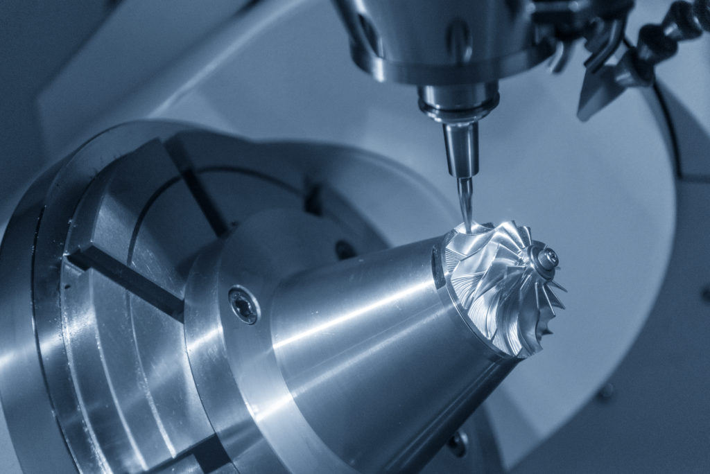 The 5-axis Cnc Milling Machine Cutting The Turbine Part With The